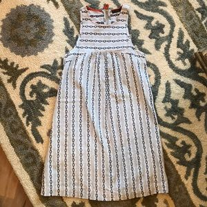 Gray and white dress with black pattern detail.